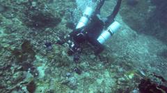 Scuba diver taking macro photos underwater Stock Footage