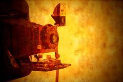Stock Illustration of vintage bellows camera grunge background