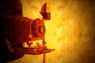 Stock Illustration of vintage bellows camera grunge background
