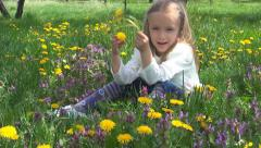 Child Playing Dandelion in Park, Kid, Little Girl Smelling Flowers on Meadow - stock footage