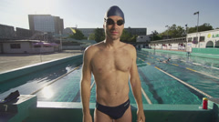 Slow Motion Portrait Shot Of Swimmer Standing By The Swimming Pool Stock Footage