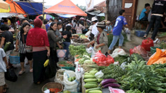 Fruit and vegetables at busy morning market Stock Footage