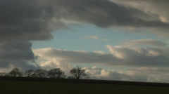 Clouds moving over trees , winter in England Stock Footage