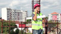 Architect With Personal Protective Equipment Using Cell Phone Stock Footage