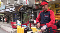 Selling fruit juice, fresh orange juice, on streets of Ankara, Turkey Stock Footage