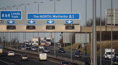 Rush hour traffic traveling on the A1/M motorway Leeds, UK Stock Footage