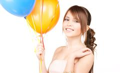 happy teenage girl with balloons - stock photo