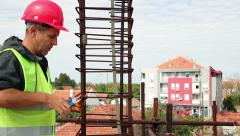 Construction Worker Preparing Steel Bars to Reinforce Concrete Stock Footage