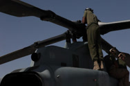 Stock Video Footage of Routine maintenance on AH-1W Cobras and UH-1Y Venoms