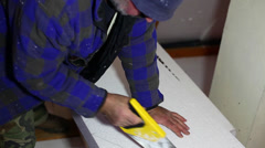 Cutting the styrofoam insulation - stock footage