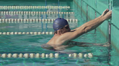 Slow Motion Of Swimmer Pushing Off In Streamline Stock Footage
