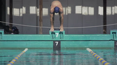 Slow Motion Of Professional Swimmer Jumping Off The Starting Block Stock Footage