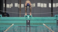 Stock Video Footage of Slow Motion Of Professional Swimmer Jumping Off The Starting Block