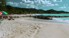 Antigua Jolly Beach 083, wide view over the sands, green hills in background Stock Footage