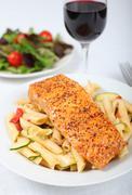 Baked salmon with pasta Stock Photos