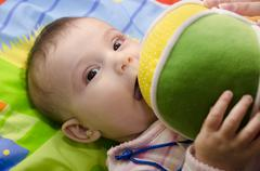 Baby and ball Stock Photos