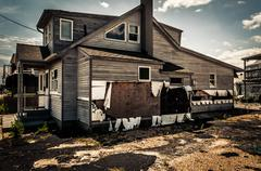 house damaged by hurricane sandy, in point pleasant beach, new jersey. - stock photo