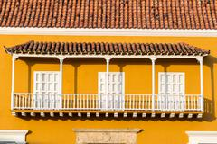 Yellow and white colonial balcony Stock Photos