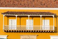 Stock Photo of yellow and white colonial balcony