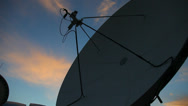 Stock Video Footage of An antenna searching for a channel at sunset