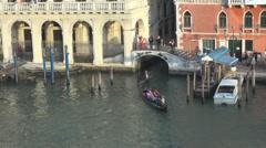 Closeup gondola travel enjoy holiday Grand Canal people walk bridge day Venice Stock Footage
