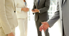 Business people shaking hands and talking Stock Footage
