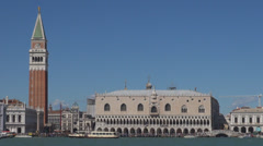 Piazza San Marco St Mark's Square old port facade Campanile Piazzetta column Day Stock Footage