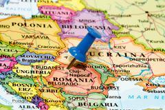 Map of romania with a blue pushpin stuck Stock Photos