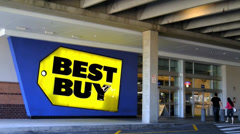 Best Buy entered by young couple - stock footage