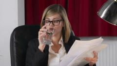 Young Businesswoman Reads Script And Drinks Water Stock Footage