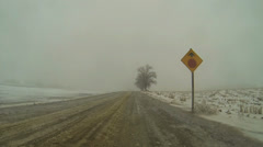 A Point of View (POV) drive after an ice storm - stock footage