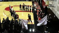 High school basketball team entering court Stock Footage