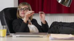Young Businesswoman Files Her Nails Stock Footage