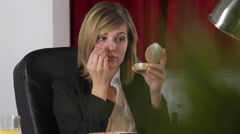Pretty Office Lady Applies Make-Up Foundation And Lip Gloss - stock footage