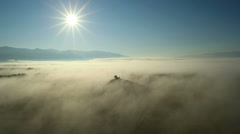 Flight in fog over fields and mountains. Altai. Siberia. Stock Footage