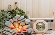 Stock Photo of candles, stones for sauna and bath accessories.