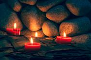 Stock Photo of candles are lit on the background of the sauna stones. preparing for the cere