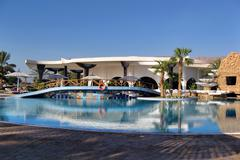 EGYPT - beautiful resort with palms and pool - stock photo