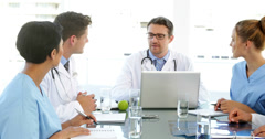 Doctor talking with his staff during a meeting - stock footage
