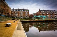 Stock Photo of reflections of waterfront apartments on the potomac river, in alexandria, vir