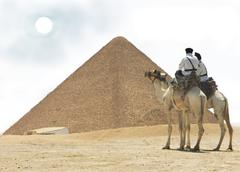 Egypt -  Cairo, Giza - two cops on camel - stock photo