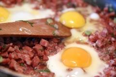 Cooking - three egg with cut sausage Stock Photos