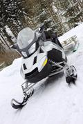 Modern silver scooter on snow Stock Photos