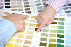 business people with swatches to decide the color of the office - stock photo