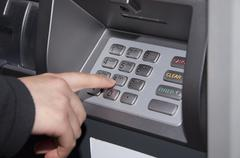 Someone pressing number button on atm machine Stock Photos