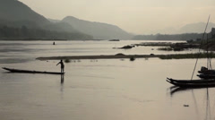 A single fisherman on  the  Mekong River in Laos. - stock footage