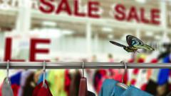 sale in shop concept animation with fashion and flying butterfly - stock footage