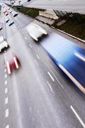 Highway with lots of cars. High contrast and motion blur to rise speed. Stock Photos