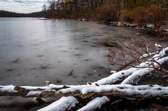 Sunfish pond covered in snow and ice, in delaware water gap national recreati Stock Photos