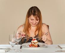 Teen girl eating pancake Stock Photos